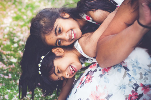 Photo of 2 girls playing during a photo shoot