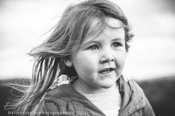 Photo of a girl in the wind during a children photo shoot