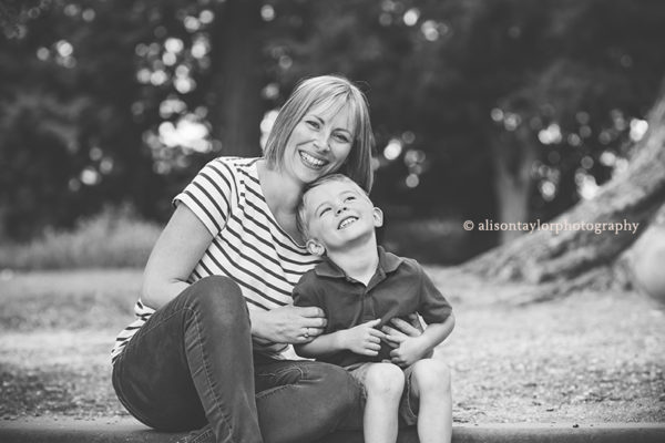 photo of a mother and her young son sitting on some steps during a photo shoot in Bristol